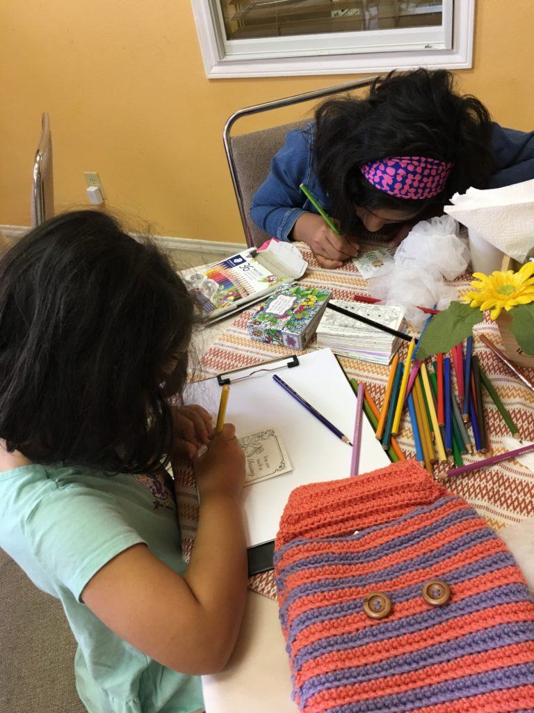Girls writing letters for Women's prison ministry