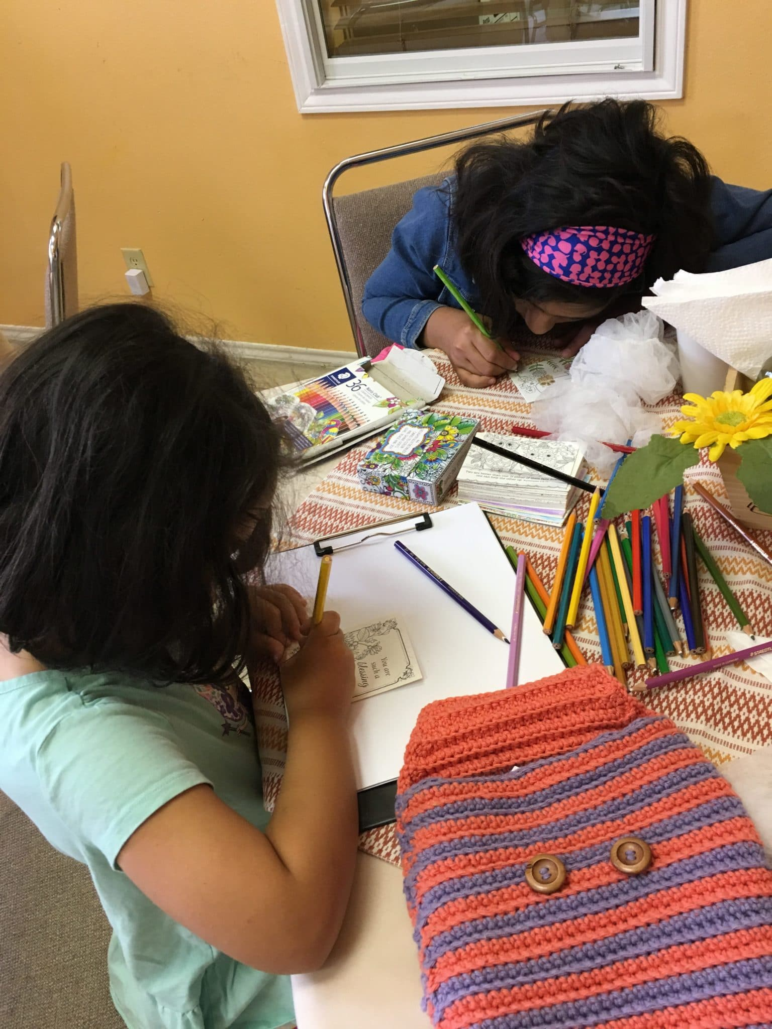 Pix if girls writing letters to women's prison ministry.